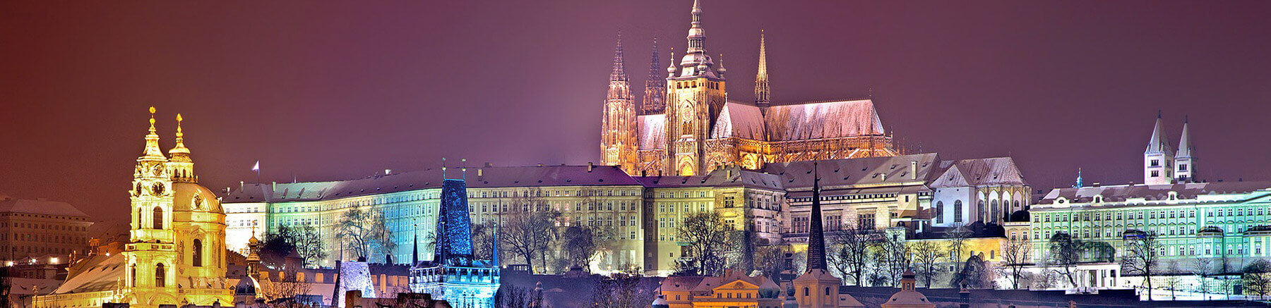 Photo of Prague by night featuring Prague Castle