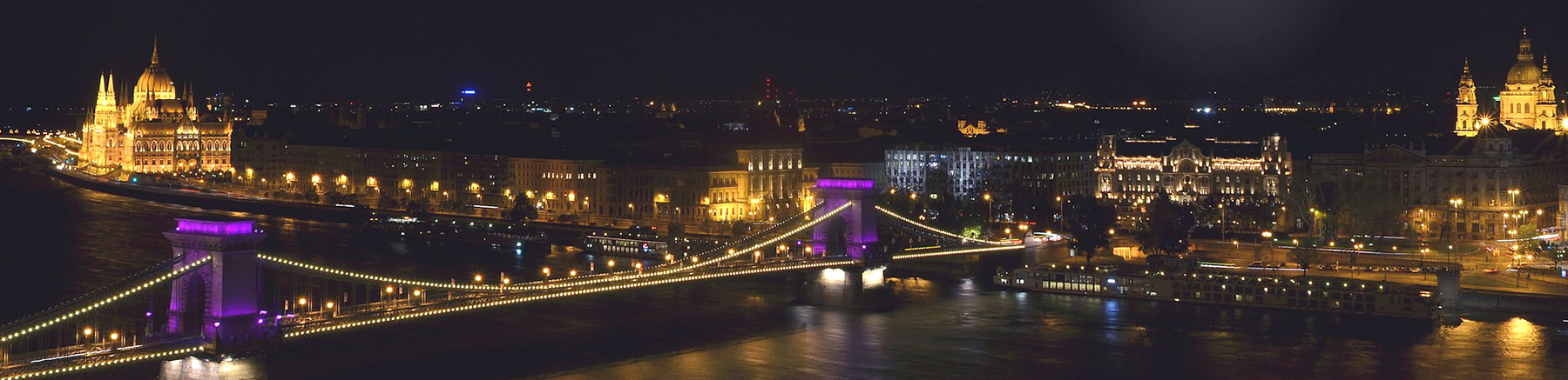 View of Budapest by night with the Széchenyi Chain Bridge and the massive parliament building
