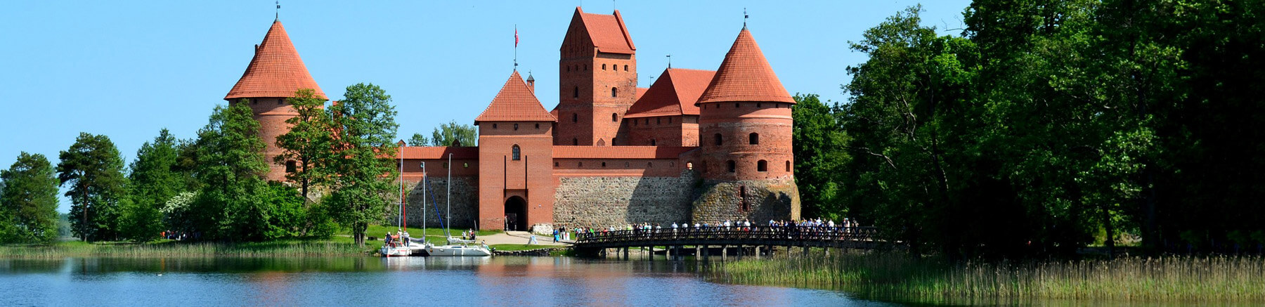 Trakai Island Castle in Lithuania with Lake Galvė in the foreground