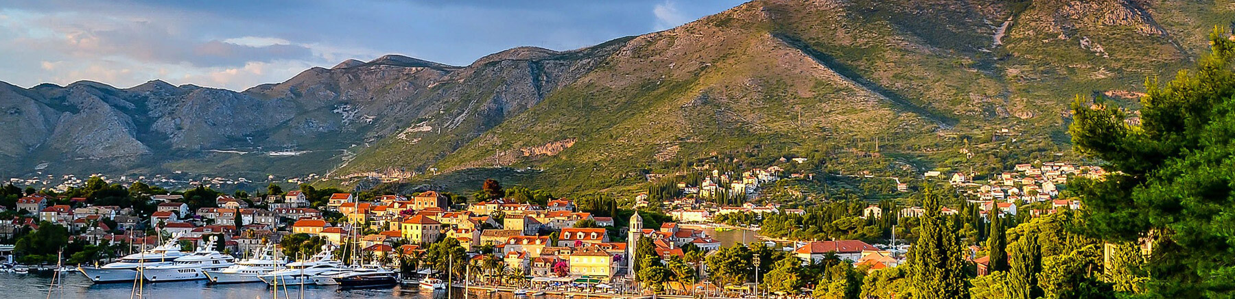 Coastal city of Montenegro with the mountains in the background