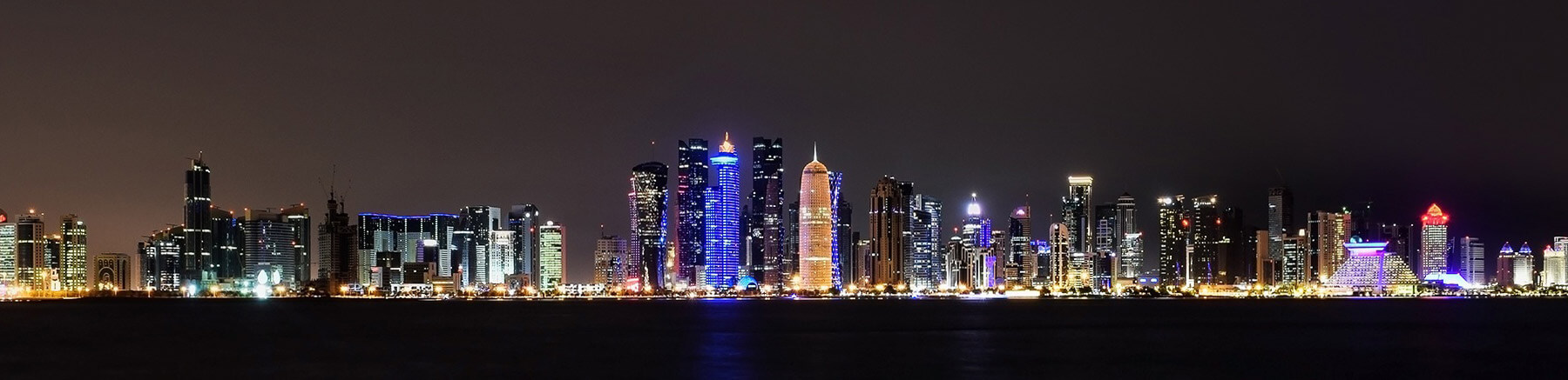 Panoramic view of Doha' skyline in Qatar by night