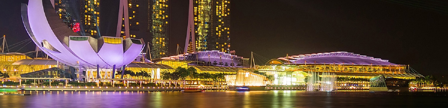 Singapore's Marina Bay at the end of the day with a boat in the foreground