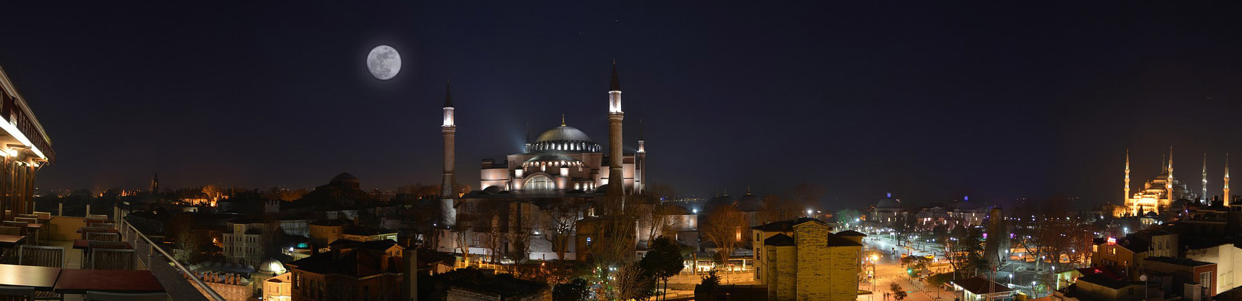 View of Hagia Sophia in Istambul, Turkey with a full moon in the sky
