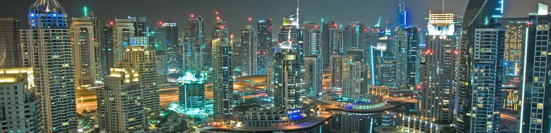 Broad aerial view of Dubai, United Arab Emirates by night