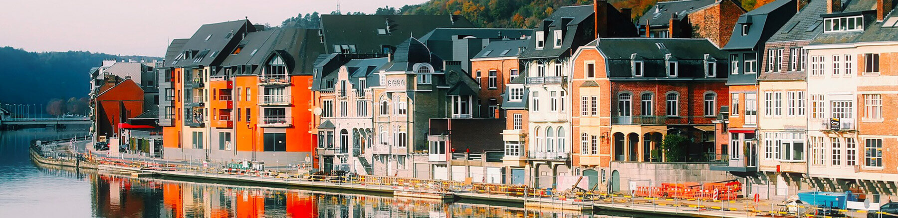 Colourful houses along a river in Belgium