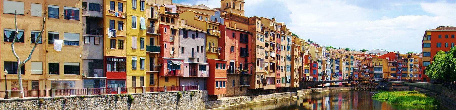 View of Girona and it's colourful houses on the bank of the river