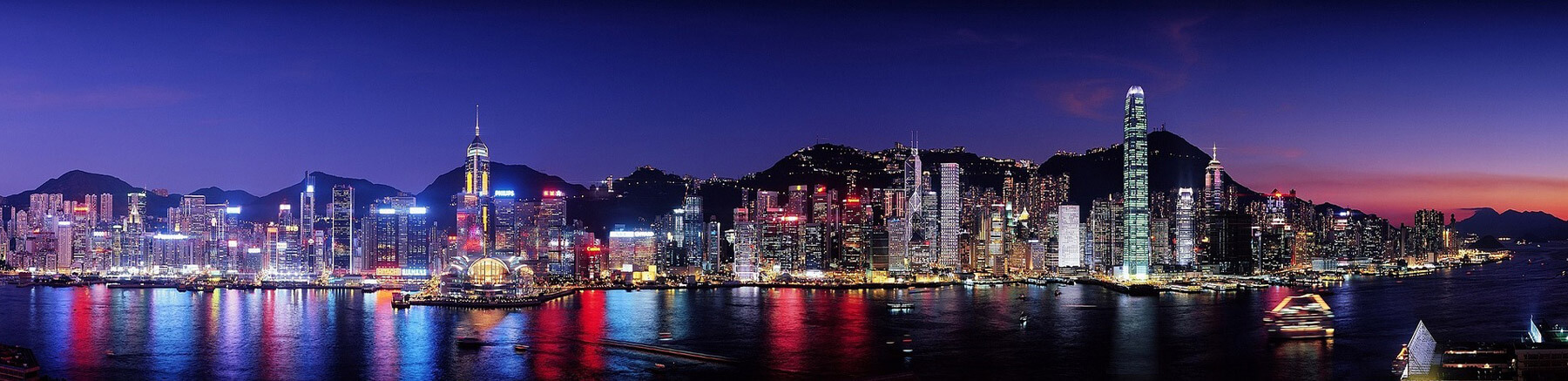 Hong Kong breathtaking panoramic view by night with the city in the foreground