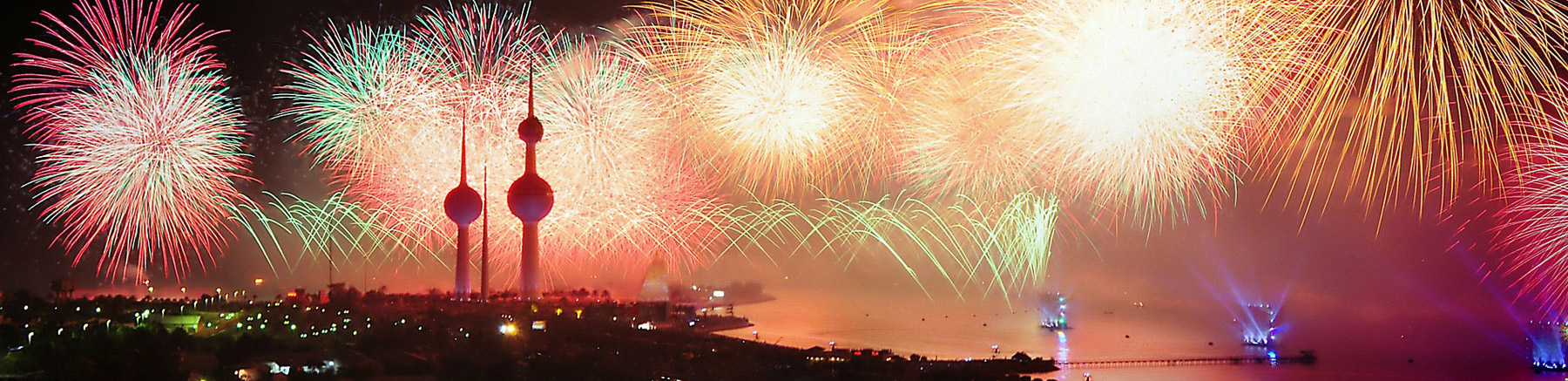 Fireworks in Koweit City with a view over the bay and the three Kuwait Towers